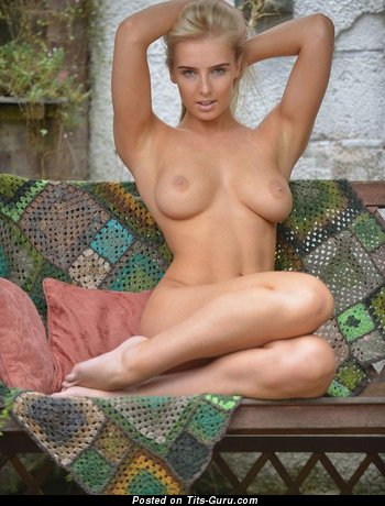 Image. Nude blonde with medium natural breast pic