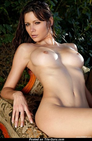 Image. Naked brunette with medium natural tittes photo
