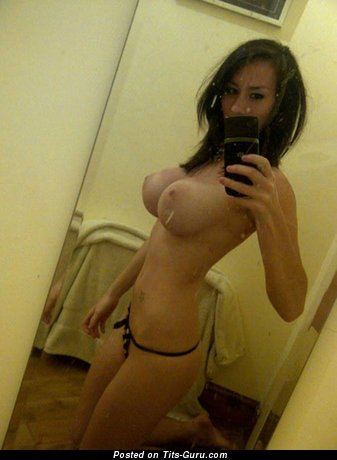 Image. Sexy topless amateur brunette with big fake boobs selfie