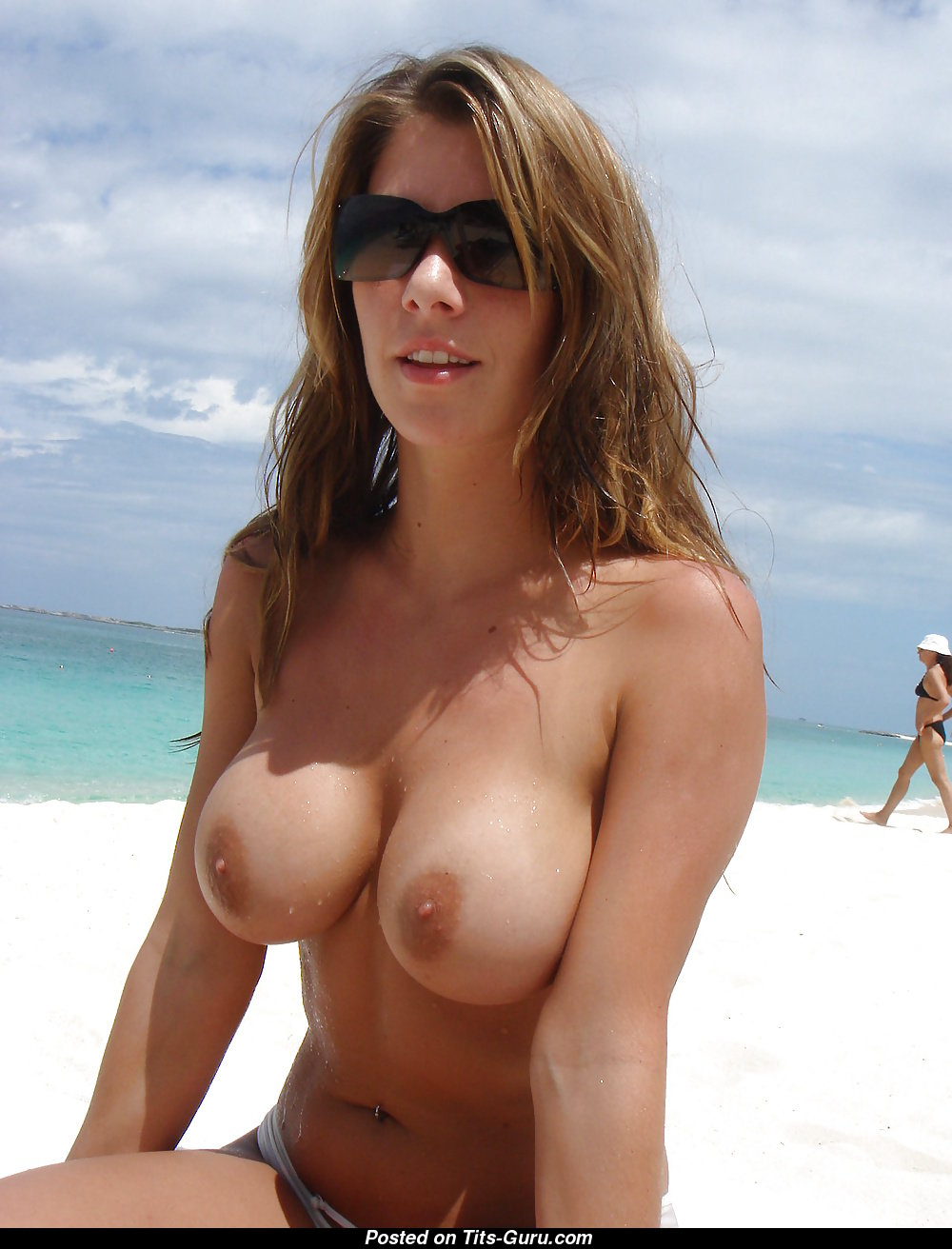 Bare beach tits