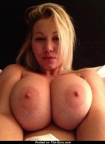 Image. Blonde with huge tits photo