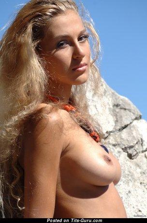 Image. Naked beautiful lady with medium natural boobs image