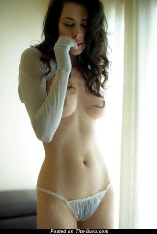 Image. Naked wonderful female with medium natural boobies picture