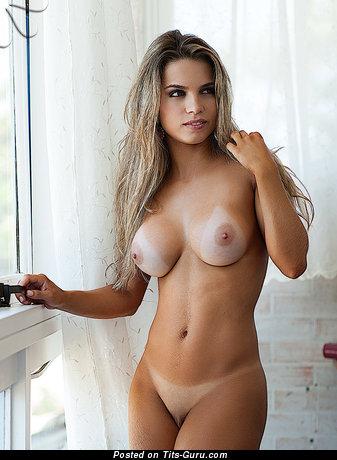Topless latina blonde with medium tots pic