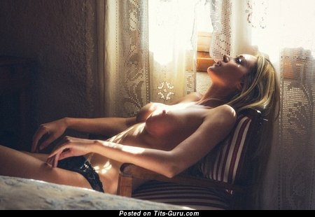 Image. Topless blonde with medium tits picture