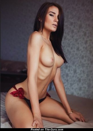 Image. Nude brunette with medium natural tots pic