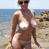 Topless amateur blonde with natural boobies picture