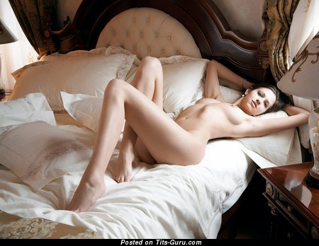 Image. Naked brunette with medium natural tittes pic