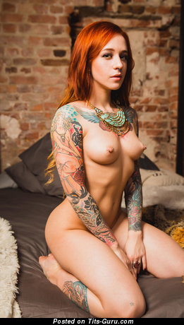 Image. Nude beautiful female with medium natural boobies, piercing, tattoo and big nipples pic