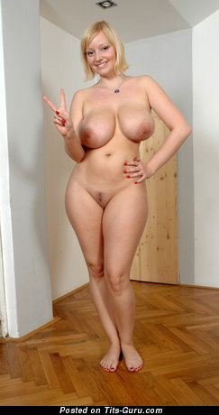 Amateur naked blonde with huge natural tots picture