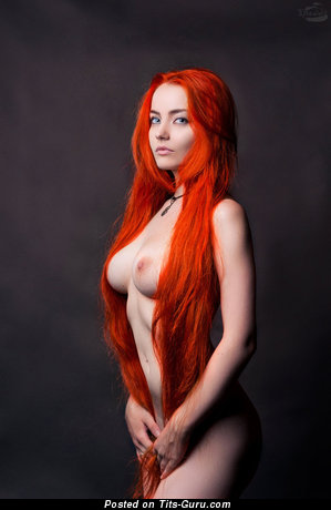 Image. Red hair with medium natural tits photo