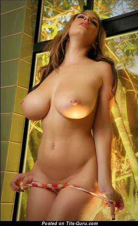 Image. Naked wonderful woman with big boobies and piercing photo