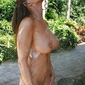 Wet hot lady with big tits image