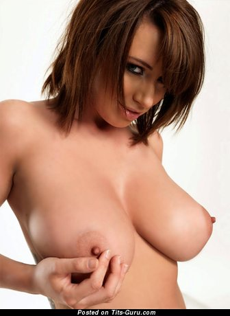 Image. Sexy topless brunette with medium natural tits and big nipples picture