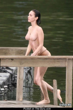 Megan Fox - wet topless brunette with medium fake tots, tattoo and big nipples pic