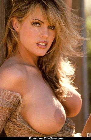 Sexy nude blonde with medium boob photo