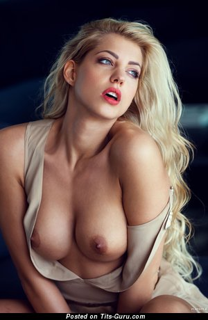 Image. Sarah Nowak - naked blonde with medium natural tittes and piercing pic