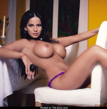 Image. Nude beautiful female with fake breast image