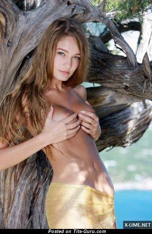 Image. Naked wonderful girl with medium natural boobs photo
