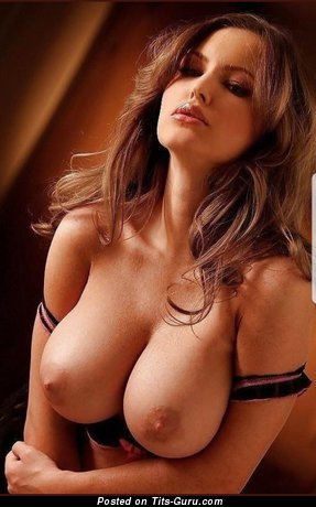 Sexy topless brunette with medium boobies photo