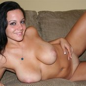 Sexy topless amateur brunette with big tittes photo