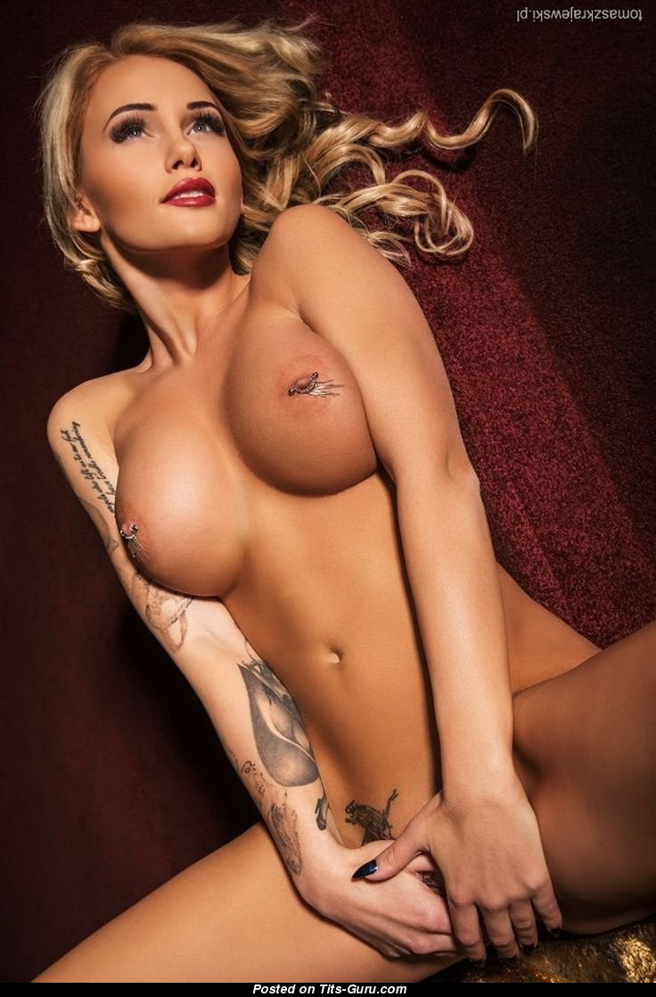 naked blonde with big fake boob, piercing and tattoo picture | 14.05