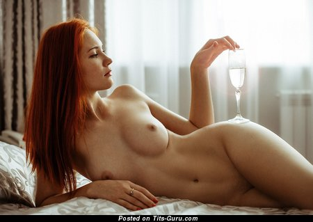 Image. Sexy nude red hair with natural tots photo