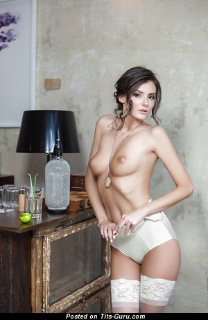 Image. Sunshine - brunette with medium natural tots and big nipples picture