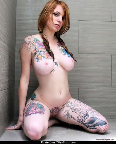 Image. Naked beautiful girl with huge natural breast and tattoo image