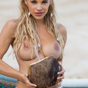 Sexy topless blonde with medium natural breast and big nipples image