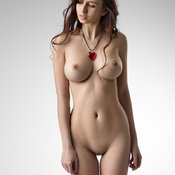 Sexy topless brunette with medium natural breast and big nipples photo