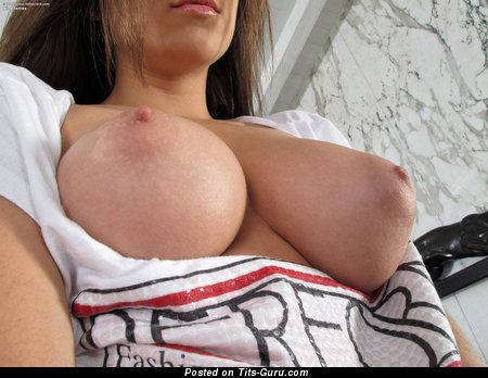 Image. Nina James - nude brunette with medium natural tittes and big nipples photo