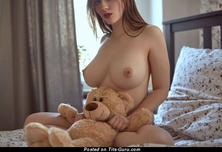 Topless amateur wonderful female with medium natural boobs and big nipples photo