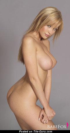 Emily Scott - sexy nude blonde with medium fake breast image