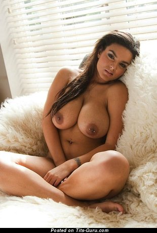 Image. Sexy topless brunette with big natural boobs and piercing image