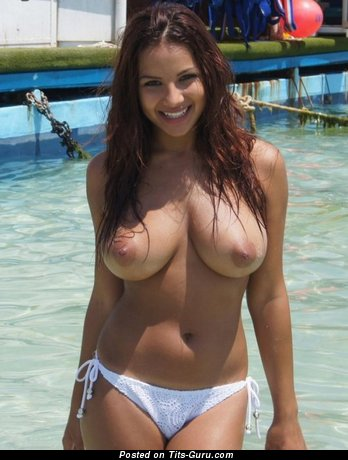 Sexy topless brunette with medium natural breast picture