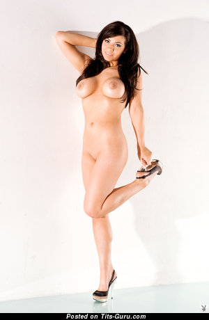 Image. Nude brunette with medium fake boobies pic