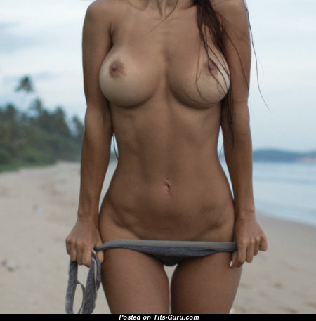 Nice Topless Gal with Nice Open Natural Regular Melons is Undressing on the Beach (Xxx Picture)