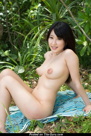 Naked asian with medium natural tittes and big nipples image