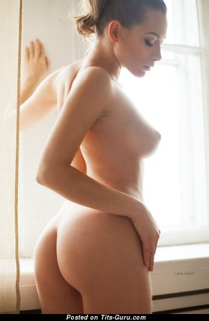 Image. Sexy topless amateur blonde with medium natural boobies image