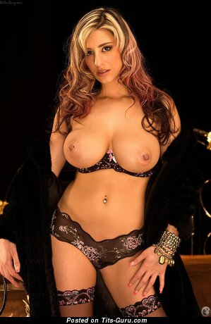 September Carrino - sexy naked blonde with big tittys and piercing image