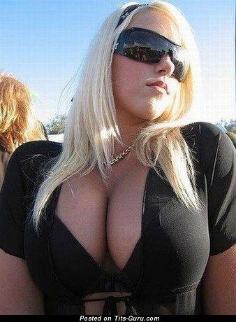 Image. Nice woman with huge boobies photo