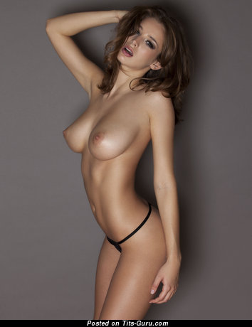 Image. Topless brunette with big natural breast pic