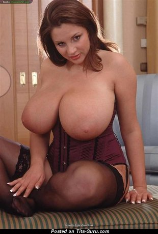 Nadine Jansen - sexy naked red hair with fake tittys photo