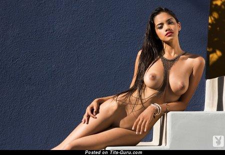 Image. Naked beautiful lady with medium natural tits photo