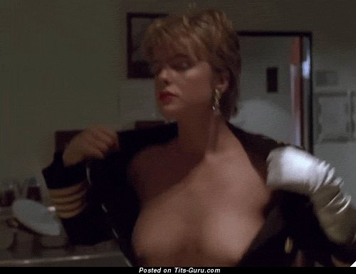Image. Erika Eleniak - naked blonde with medium fake boob gif