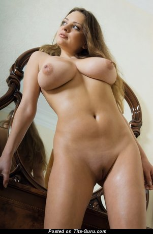 Image. Naked blonde with huge natural boobs and big nipples photo