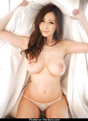 Sexy naked asian brunette with medium natural tots and big nipples pic