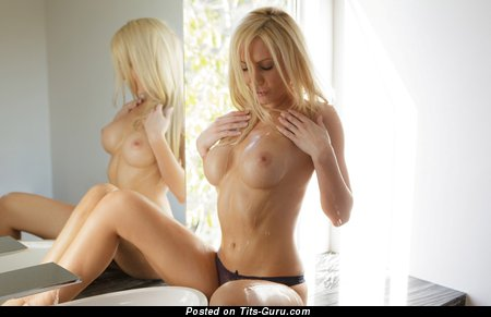Topless blonde with medium fake tittys image