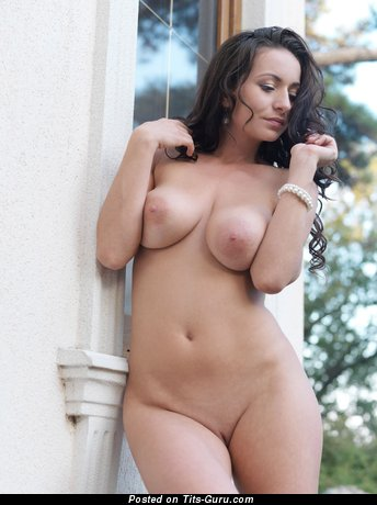 Nude brunette with big natural tots and big nipples image